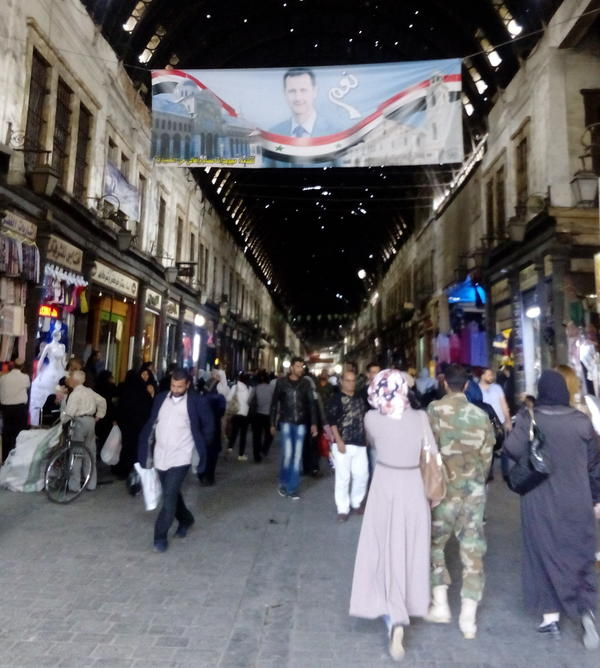 The ancient Hamidiyeh bazaar in Damascus is still flush with shoppers despite five years of war. The Syrian capital can feel far removed from the fighting.