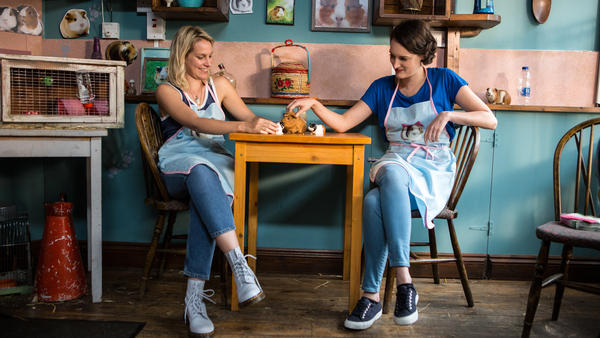 In the show, <em>Fleabag</em> (Phoebe Waller-Bridge, right) copes with the death of her best friend, Boo (Jenny Rainsford). Before Boo died, the two ran a guinea pig-themed cafe together.
