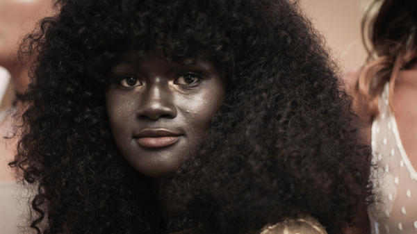 Khoudia Diop didn't realize her skin color was special until she left Senegal.