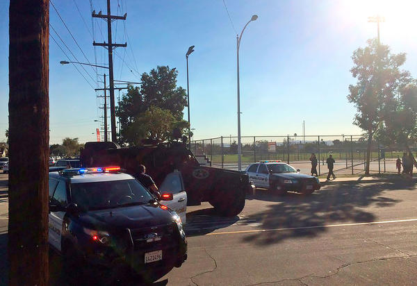 This photo provided to the AP shows police vehicles outside a middle school in Asuza, Calif., Tuesday following reports of a shooting near the Los Angeles-area polling site.