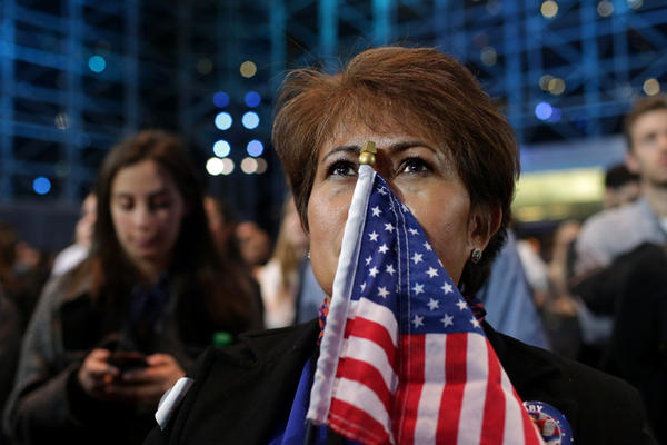 """Teary-eyed Rebecca Canalija, 57, waits for Democratic presidential nominee Hillary Clinton to address the crowd in New York City on Tuesday. Canalija called Donald Trump's win """"tragic"""" and said she is feeling depressed over it."""
