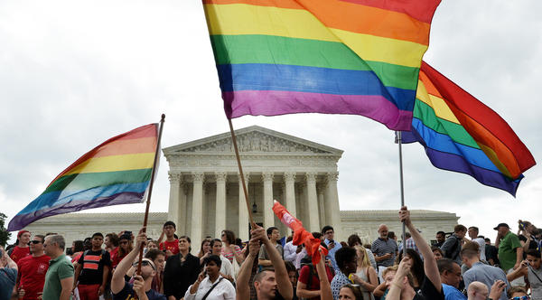 People celebrate outside the Supreme Court in Washington on June 26, 2015, after its historic decision on gay marriage.