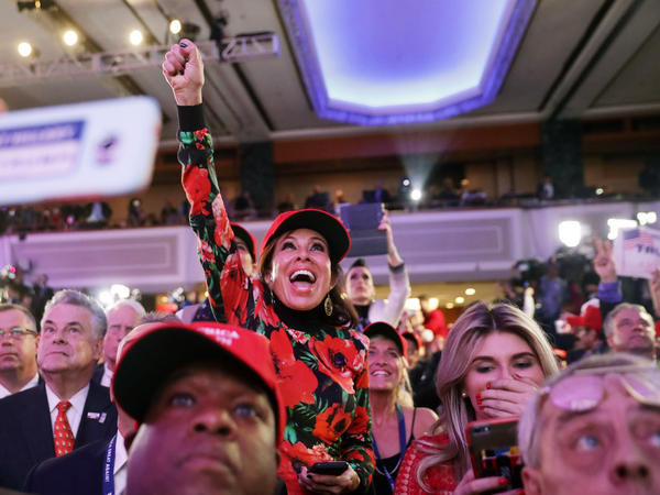 Donald Trump supporters cheer on Tuesday night at the New York Hilton Midtown.