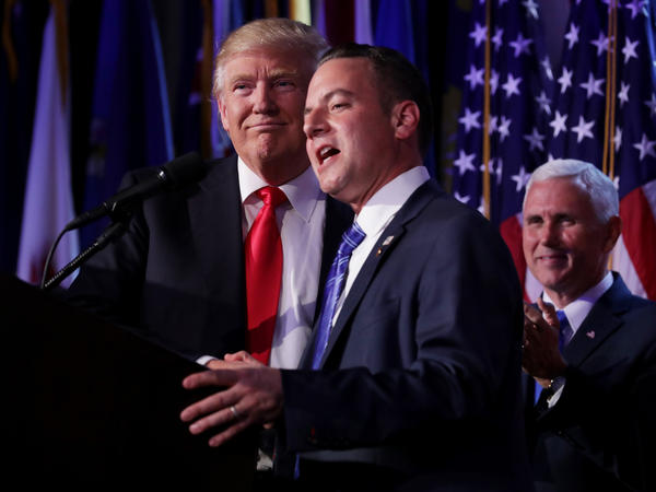 Reince Priebus, chairman of the Republican National Committee, delivers a speech as Republican President-elect Donald Trump looks on during his election night event in New York City.