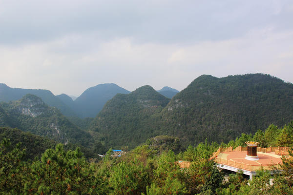 Guizhou Province's karst mountains surround the telescope and block out  interference that would block distant signals.