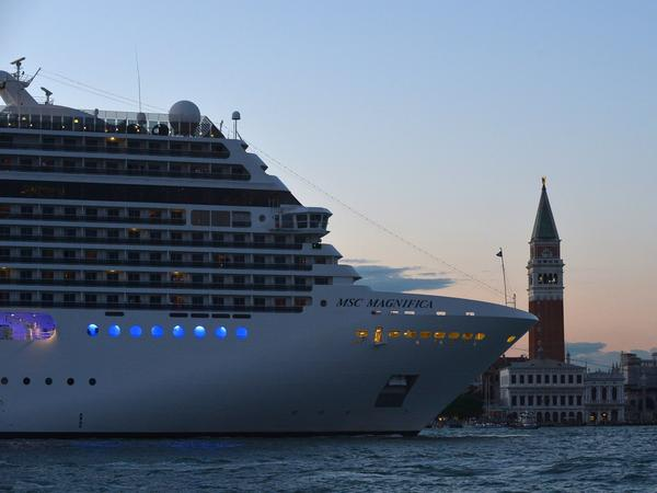 A cruise ship passes Venice's St. Mark's Square at sunset in September. Up to 90,000 tourists fill the city every day, far outnumbering the 55,000 residents.