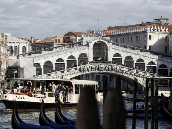 People gather on the Rialto Bridge to protest on Nov. 12 against the increasing number of tourists in Venice.