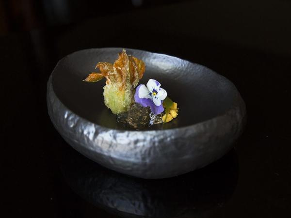 Blue crab, zucchini blossom and carrot served at N/Naka. The waiting list for Nakayama's restaurant is three months long, and it's not inexpensive. For nearly $200 each, diners can enjoy a 13-course, artfully plated culinary experience.