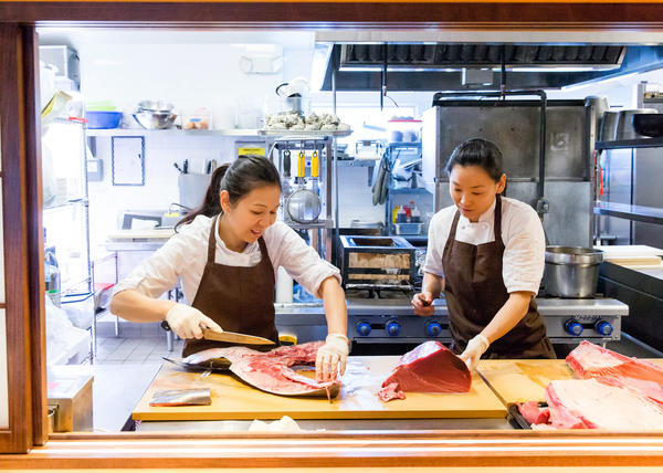 Chef Niki Nakayama in the kitchen with her wife and sous chef, Carole Iida-Nakayama. Nakayama is a modern master of the ancient Japanese art of kaiseki, a local, seasonal, multicourse meal rooted in Eastern philosophies that value being in harmony with nature.