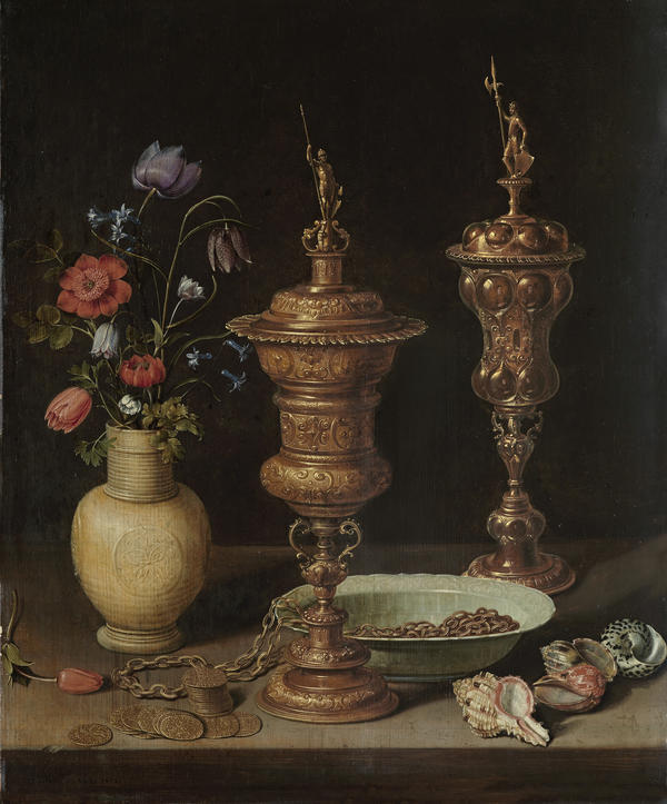 <em>Still life with Flowers, Gilt Goblets, Coins and Shells</em> was created by Clara Peeters in 1612. Peeters hid small self portraits in the goblet on the right.