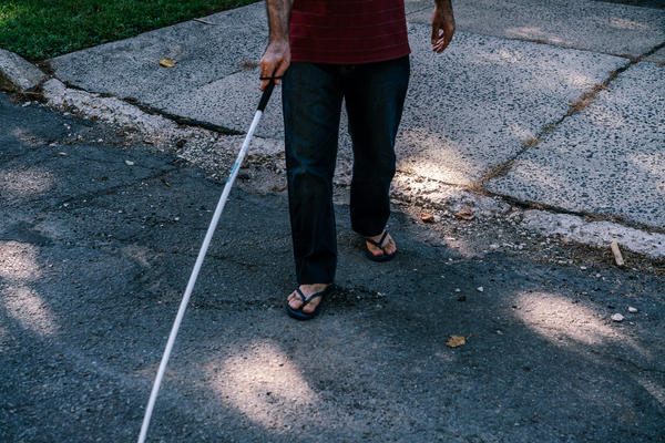 Osama walks outside after his and his wife's English class. He was blinded in a military attack on his uncle's home in a Damascus suburb in 2012.