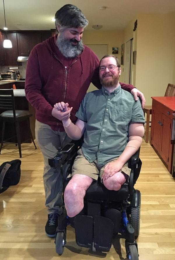 Will Lautzenheiser and his partner Angel Gonzalez at their home in Brookline, Mass. (Samantha Fields/Here & Now)