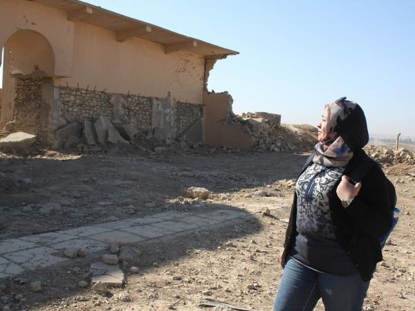 Archaeologist Layla Salih looks around the ancient site of Nimrud, in northern Iraq, outside Mosul. The Islamic State captured the area in 2014 and destroyed many of its archaeological treasures that date back 3,000 years. The extremist group was recently driven out of Nimrud, allowing Salih and others to come back and survey the extensive damage.