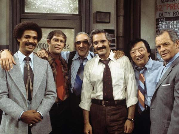 "The cast of ""Barney Miller"" in September 1976: Ron Glass, Max Gail, Hal Linden, Abe Vigoda, Jack Soo."