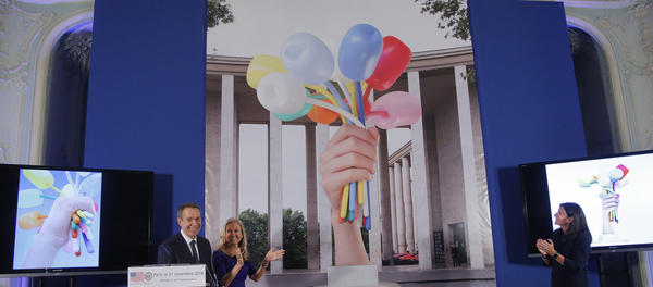 American artist Jeff Koons, left, American ambassador Jane Dorothy Hartley and Mayor of Paris Anne Hidalgo unveil illustrations of <em>Bouquet of Tulips 2016,</em> a 34-foot statue Koons is presenting to the city of Paris and the people of France as a symbol of friendship.