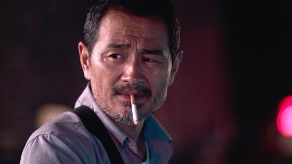 Chen Gang as a taxi driver in <em>Old Stone,</em> director Johnny Ma's debut feature.