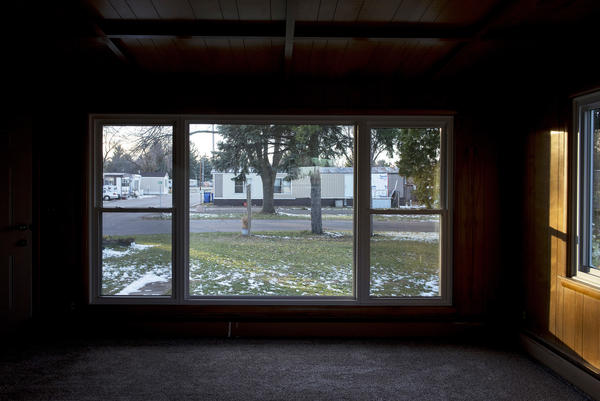 Homes at Park Plaza Cooperative are seen through the window of a rental home.