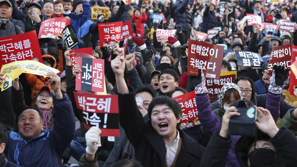 Protesters celebrate Friday after hearing that the National Assembly voted to impeach President Park Geun-hye in Seoul, South Korea. It marked a stunning and swift fall for the country's first female leader. Her powers are suspended and a constitutional court will now decide whether to remove her from her post.