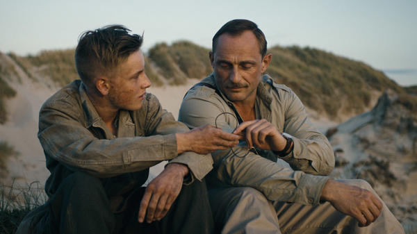 Louis Hofmann (left) and Roland Møller (right) in <em>Land of Mine.</em>