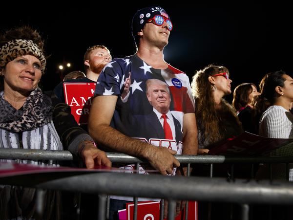 Supporters of Republican presidential candidate Donald Trump listen as he speaks during a campaign rally in October in Cedar Rapids, Iowa.