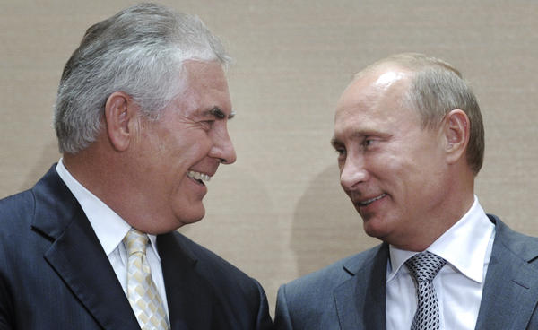Russian leader Vladimir Putin (right), and Rex Tillerson, the head of ExxonMobil, smile during a signing ceremony for an oil agreement in Sochi, Russia, in 2011. Tillerson is widely reported to be President-elect Donald Trump's favored choice for secretary of state. U.S. policy toward Moscow used to be a unifying issue among Republicans and Democrats, but now it's a source of division.