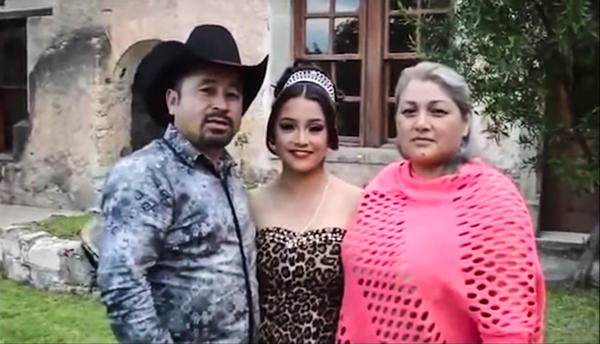 Rubi Ibarra Garcia, center, and her father and mother.