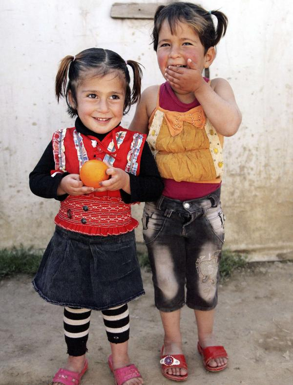 Two little girls photographed at the Syrian refugee camp in Lebanon's Bekaa Valley two years ago. Massaad says most of the families there when she visited were from Homs and Idlib, Syria.
