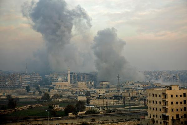 Smoke billows from the former rebel-held district of Bustan al-Qasr in Aleppo on Monday during an operation by Syrian government forces to retake the embattled city.
