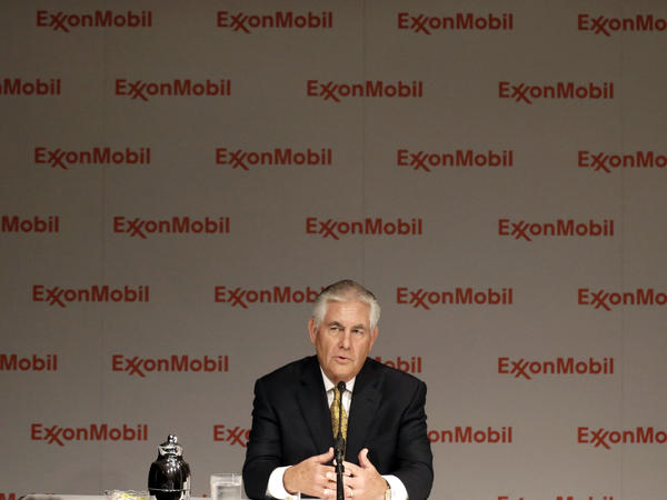Exxon Mobil CEO Rex Tillerson speaks to reporters after the annual Exxon Mobil shareholders meeting in 2014.