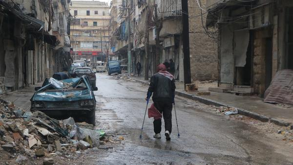 A man walks with crutches through a devastated part of eastern Aleppo on Wednesday.