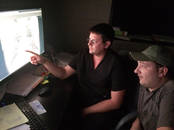 Radiologist Brandon Crum and former coal miner Mackie Branham, 39, view an X-ray of Branham's diseased lung at Crum's black lung clinic in Coal Run Village, Ky.