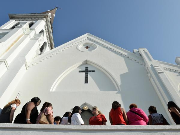 People line up to enter for Sunday service at the Emanuel AME Church in Charleston, S.C.