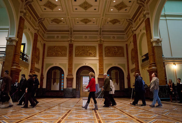 Docents on the America InSight tours guide visitors through the Smithsonian American Art Museum.