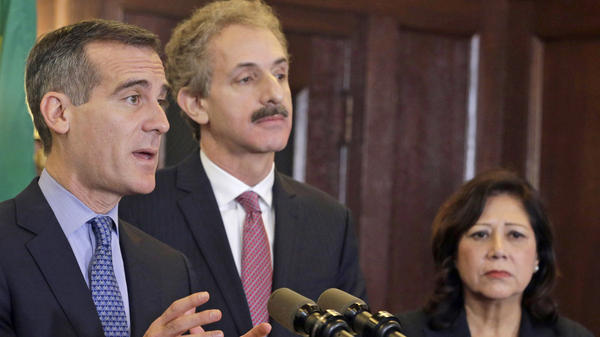 Los Angeles Mayor Eric Garcetti, City Attorney Mike Feuer and County Supervisor Hilda Solis announce the creation of a $10 million fund to provide legal assistance to immigrants facing removal proceedings.