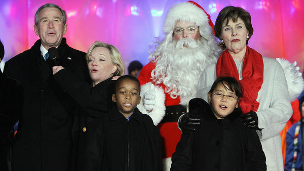 President George W. Bush and first lady Laura Bush sing a Christmas carol with Cathy Rigby and Santa Claus after lighting the National Christmas Tree in 2006.