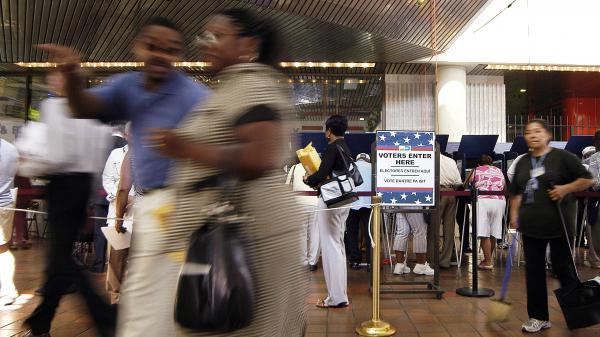 Latino voters go to the polls for early voting at the Miami-Dade Government Center on October 21, 2004 in Miami, Florida. A key constituency in Florida, many wondered how conservative Latinos would vote after now President-elect Trump's remarks on immigration.