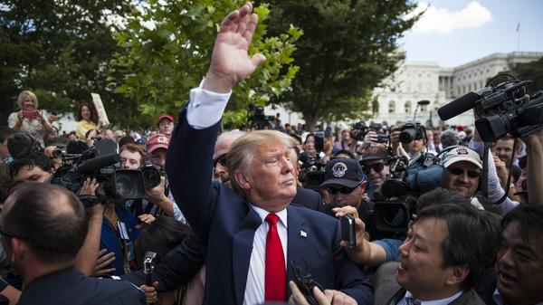 """Trump waives to supporters at a  Tea Party in Washington in September 2015. """"For the first time our people are in the room, you know?"""" says a Tea Party leader."""
