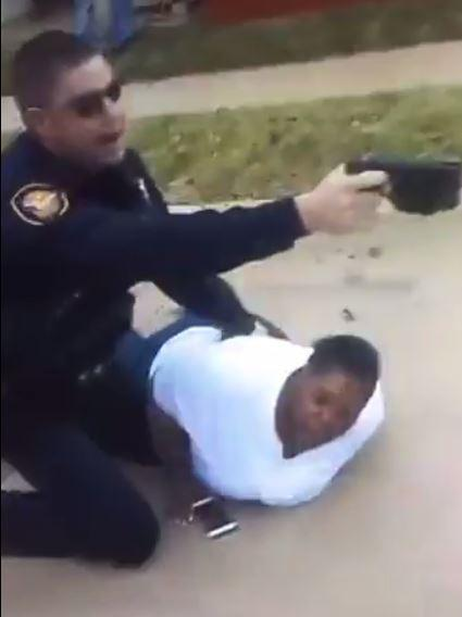 A screen grab from a video posted by Jacqueline Craig's niece shows an officer holding Craig on the ground while issuing commands. Police arrested Craig after she called to report a man had grabbed her son and accused him of littering.
