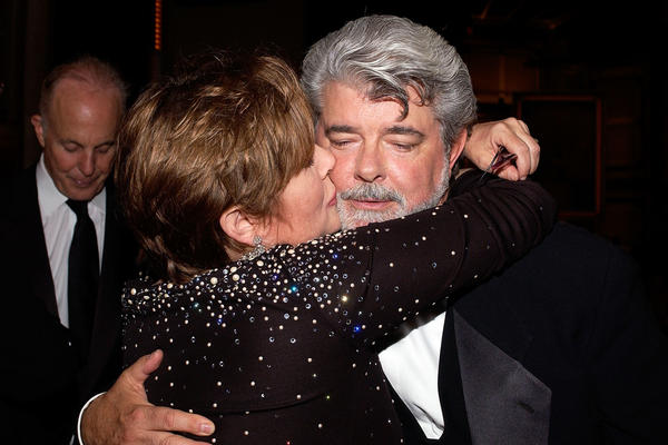 Carrie Fisher and director George Lucas pose at the dinner during the 33rd AFI Life Achievement Award tribute to Lucas in 2005.