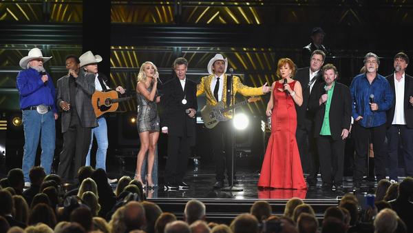 Left to right: Charlie Daniels, Charley Pride, Dwight Yoakam, Carrie Underwood, Randy Travis, Brad Paisley, Reba McEntire, Vince Gill, Jeff Cook, Randy Owen and Teddy Gentry perform onstage at the 2016 CMA Awards in Nashville.