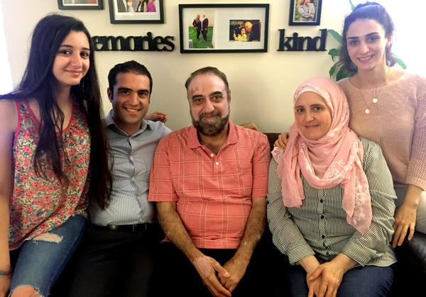 Almothana Alhamoud (second from left) with his family in Chicago. From left to right are his sister, Fatina; their father, Abdel Bari; their mother, Alia; and his other sister, Rowan. Alhamoud earned a computer engineering degree in Syria, but when he came to the U.S., he initially worked as a cashier. The group Upwardly Global helped him find a job in IT.