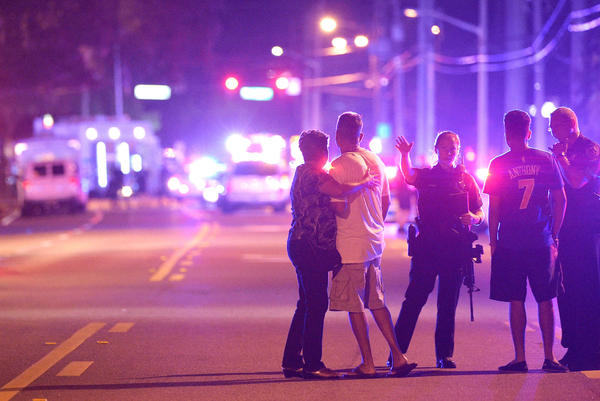Orlando Police officers direct family members away from a fatal shooting at Pulse Orlando nightclub in Orlando, Fla., in June.