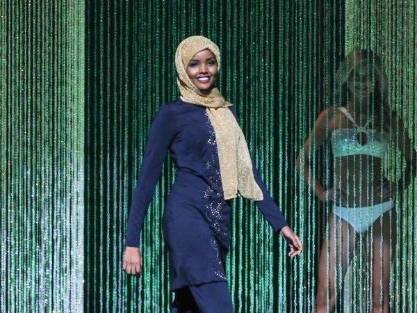 "Halima Aden wore a navy blue, embroidered burkini --€"" a full-body bathing suit --€"" during the swimsuit competition."