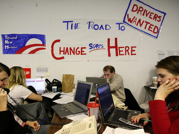 "Volunteers in Des Moines make calls at the campaign headquarters of then-Democratic presidential hopeful Sen. Barack Obama on Dec. 5, 2007 ahead of the Iowa caucus. Obama has called those ""fired-up"" campaign workers from his 2008 campaign, one of his proudest legacies."