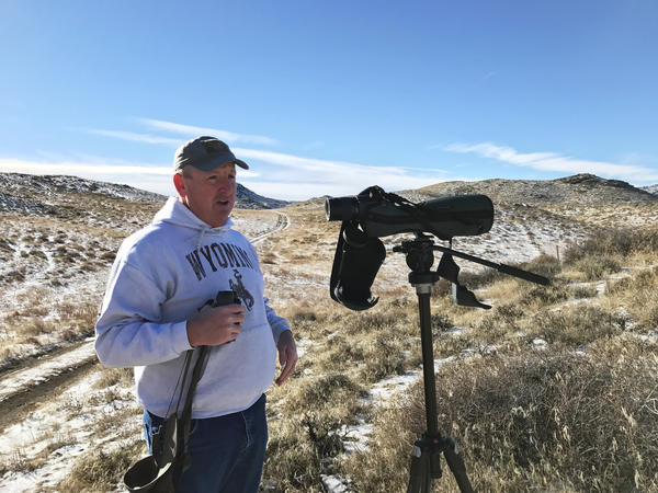 Buzz Hettick scans federal Bureau of Land Management land near his home in Laramie, Wyo., scouting for an upcoming hunt. He worries the proposed transfer of federal lands to the states would jeopardize the public's access to these lands.