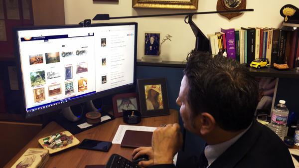Lt. Francesco Ficarella searches the art squad's Leonardo database.