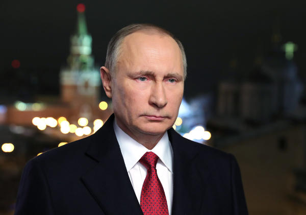Russian President Vladimir Putin speaks during his annual televised New Year's message in the Kremlin in Moscow.
