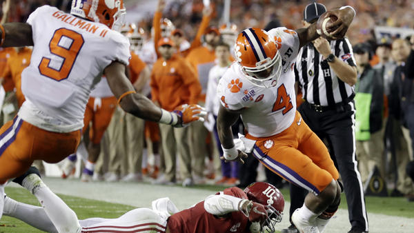 Clemson quarterback Deshaun Watson runs along the sideline for a touchdown Monday against Alabama during the first half of the NCAA college football playoff championship game in Tampa, Fla.