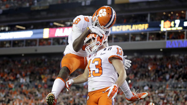 Wide receiver Hunter Renfrow of the Clemson Tigers celebrates with wide receiver Deon Cain after a 24-yard touchdown pass in Monday night's championship game.