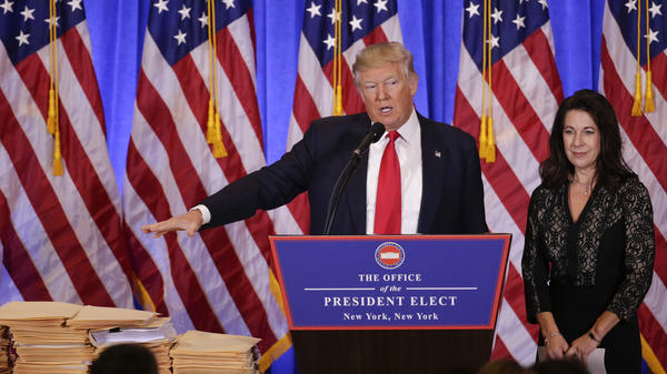 President-elect Donald Trump speaks as one of his attorneys listens during a news conference Wednesday at Trump Tower in New York.